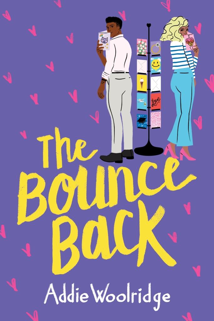 A picture of a book cover, with the title The Bounce Back in yellow. The background is purple with pink hearts and there is a couple standing on the front holding greeting cards and smiling.